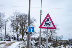 Railway crossing with signs and rails Stock Photography
