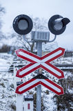 Railway crossing with signs and rails Royalty Free Stock Photography