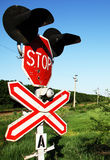Railway crossing stop sign. With old paint & surface scratches stock photography