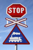 Railway crossing stop sign Stock Images