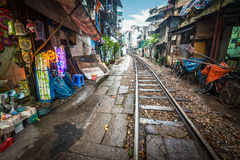 Railway crossing the street in city, Vietnam. stock images