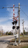 Railway crossing. On a sunny day with a blue sky stock photo