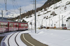 Railway crossing at Val Bernina. Winter scene near railway crossing at the Bernina Pass Stock Photos