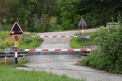 Free Railway Crossing With A Closed Barrier Or Gates And Signaling Stock Images - 190746574