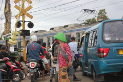 Railway Crossings. Jakarta, Indonesia, 3 March 2012 - Queues of vehicles at railway crossings Royalty Free Stock Photos