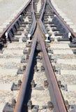 Railway crossroad on a gravel mound Stock Photo