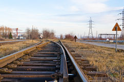 The railway a crossroads. The railway passing through an industrial zone Royalty Free Stock Image
