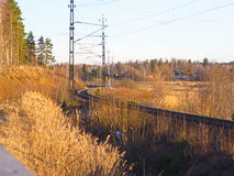 Railway curve. Curved railway with trees and blue sky Stock Photo