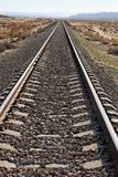 Railway in the desert converging to the horizon Royalty Free Stock Photo