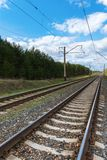 Railway with electric cables Royalty Free Stock Photography