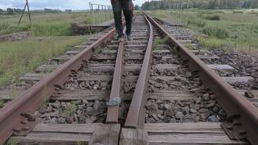 Railway employee carries out a train path. In summer day stock video footage