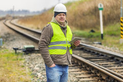 Railway employee with tablet PC near railway Royalty Free Stock Photo
