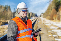 Railway employee with tablet PC on the railway Royalty Free Stock Images
