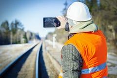 Railway engineer filmed on the railway Royalty Free Stock Photo