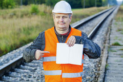 Railway Engineer with open empty book at outdoor on railway Stock Photography