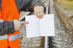 Railway Engineer with open empty book on railway Stock Photography