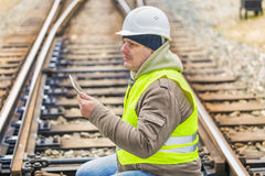 Railway engineer on rails with tablet PC Royalty Free Stock Images