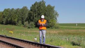 Railway Engineer with tablet PC near railway stock video
