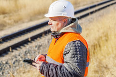 Railway Engineer with tablet PC near to railway Stock Photography