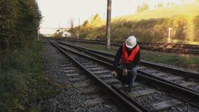 Railway Engineer walk on railway rails stock footage