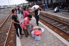 RAILWAY EXPANSION PLAN. Passengers are boarding an economy train at Solo, Java, Indonesia. Indonesian government is planning to add more 3.258 of railway tracks Royalty Free Stock Photos