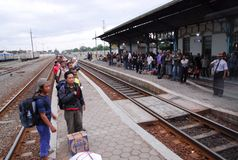 RAILWAY EXPANSION PLAN. Passengers are boarding an economy train at Solo, Java, Indonesia. Indonesian government is planning to add more 3.258 of railway tracks Stock Photography