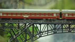 Railway express in motion. Passenger train goes over the bridge stock footage