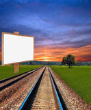 Railway in field with placard Royalty Free Stock Images
