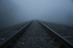 Railway in the fog.Thick fog Railway. stock image
