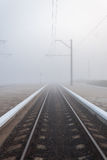 Railway in fog Royalty Free Stock Photos