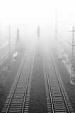 Railway in fog Stock Images