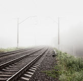 Railway in Fog. Misty Morning Landscape. Royalty Free Stock Image