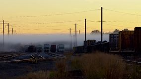Railway in fog. Rails stretching out into the fog. With rails. the railway. morning fog waiting for road trains stock video