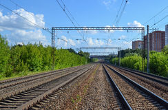Railway. Four ways out in the distance. Electrified railway. Royalty Free Stock Photo