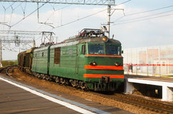 Railway freight train passes by at the turn Stock Photo