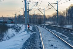 Freight cars in the winter. Railway freight train on a winter evening Royalty Free Stock Photography