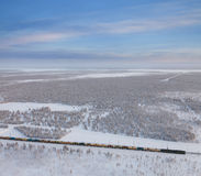 Railway with freight train in winter, top view Stock Photo