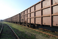 Railway freight wagons. Train, lines and perspective royalty free stock photo