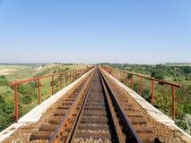 The railway goes across the bridge . The railway goes across the bridge viaduct Royalty Free Stock Photography
