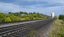 Railway goes into the distance. Stock Photos