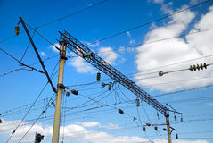 Railway high-voltage electric line. Railway high voltage line of power supplies Stock Photos