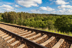 A railway on the hill with green forest on the background Stock Images