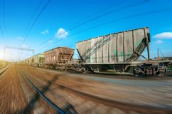 The railway hopper car for the transportation rail road train in motion at speed. Stock Image