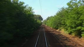 Railway journey POV. Train journey looking out to the rails stock footage