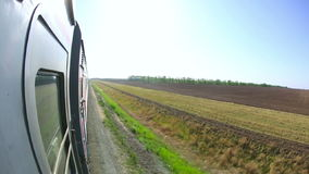 Railway journey. View to agricultural fields in Russia out of the window of moving train stock video