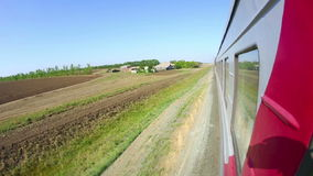 Railway journey. View to pastoral landscape in Russia out of the window of moving train stock video