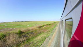 Railway journey. View to pastoral landscape in Russia out of the window of moving train stock footage
