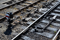 Railway junction points and signal lever. Train tracks and junction points on a British branch line Stock Photography