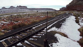 Railway laid in Canyonlands National Park. Aerial survey railway laid in Canyonlands National Park, state Utah, US. Colorful railroad tracks in the desert stock video