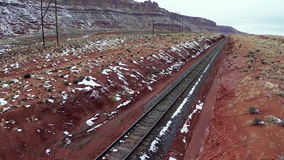 Railway laid in Canyonlands National Park. Aerial survey railway laid in Canyonlands National Park, state Utah, US. Colorful railroad tracks in the desert stock video footage